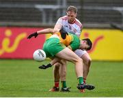 1 November 2020; Michael Langan of Donegal in action against Frank Burns of Tyrone during the Ulster GAA Football Senior Championship Quarter-Final match between Donegal and Tyrone at MacCumhaill Park in Ballybofey, Donegal. Photo by Stephen McCarthy/Sportsfile