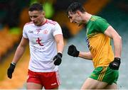 1 November 2020; Michael Langan of Donegal celebrates after scoring his side's first goal as Michael McKernan of Tyrone looks on during the Ulster GAA Football Senior Championship Quarter-Final match between Donegal and Tyrone at Pairc MacCumhaill in Ballybofey, Donegal. Photo by Harry Murphy/Sportsfile