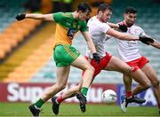1 November 2020; Michael Langan of Donegal shoots to score his side's first goal despite the attention of Brian Kennedy and Tiernan McCann of Tyrone during the Ulster GAA Football Senior Championship Quarter-Final match between Donegal and Tyrone at Pairc MacCumhaill in Ballybofey, Donegal. Photo by Harry Murphy/Sportsfile