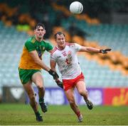 1 November 2020; Kieran McGeary of Tyrone in action against Michael Langan of Donegal during the Ulster GAA Football Senior Championship Quarter-Final match between Donegal and Tyrone at MacCumhaill Park in Ballybofey, Donegal. Photo by Stephen McCarthy/Sportsfile