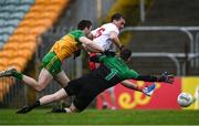 1 November 2020; Darragh Canavan of Tyrone shoots to score his side's first goal despite the attention of Eoghan Bán Gallagher and Shaun Patton of Donegal during the Ulster GAA Football Senior Championship Quarter-Final match between Donegal and Tyrone at Pairc MacCumhaill in Ballybofey, Donegal. Photo by Harry Murphy/Sportsfile