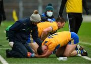 1 November 2020; Gary Brennan and Alan Sweeney of Clare receive medical attention after a collision during the Munster GAA Football Senior Championship Quarter-Final match between Tipperary and Clare at Semple Stadium in Thurles, Tipperary. Photo by Diarmuid Greene/Sportsfile
