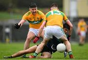 1 November 2020; Tommy Conroy of Mayo is tackled by Domnnaill Flynn, left, and Shane Quinn of Leitrim during the Connacht GAA Football Senior Championship Quarter-Final match between Leitrim and Mayo at Avantcard Páirc Sean Mac Diarmada in Carrick-on-Shannon, Leitrim. Photo by Ramsey Cardy/Sportsfile