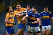 1 November 2020; Cian O'Dea and Gary Brennan of Clare tussle off the ball with Michael Quinlivan and Colman Kennedy of Tipperary at half time of the Munster GAA Football Senior Championship Quarter-Final match between Tipperary and Clare at Semple Stadium in Thurles, Tipperary. Photo by Diarmuid Greene/Sportsfile