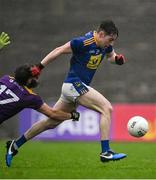 1 November 2020; Conor Byrne of Wicklow is tripped by Conor Carty of Wexford, for which Carty was shown the black card by referee Maurice Deegan during the Leinster GAA Football Senior Championship Round 1 match between Wexford and Wicklow at Chadwicks Wexford Park in Wexford. Photo by Piaras Ó Mídheach/Sportsfile