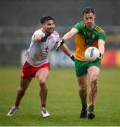 1 November 2020; Ciaran Thompson of Donegal is tackled by Tiernan McCann of Tyrone during the Ulster GAA Football Senior Championship Quarter-Final match between Donegal and Tyrone at MacCumhaill Park in Ballybofey, Donegal. Photo by Stephen McCarthy/Sportsfile