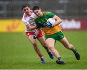 1 November 2020; Michael Langan of Donegal in action against Darragh Canavan of Tyrone during the Ulster GAA Football Senior Championship Quarter-Final match between Donegal and Tyrone at MacCumhaill Park in Ballybofey, Donegal. Photo by Stephen McCarthy/Sportsfile