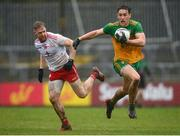 1 November 2020; Hugh McFadden of Donegal in action against Frank Burns of Tyrone during the Ulster GAA Football Senior Championship Quarter-Final match between Donegal and Tyrone at MacCumhaill Park in Ballybofey, Donegal. Photo by Stephen McCarthy/Sportsfile