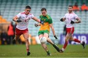 1 November 2020; Ciaran Thompson of Donegal kicks a point despite the attention of of Michael McKernan of Tyrone during the Ulster GAA Football Senior Championship Quarter-Final match between Donegal and Tyrone at MacCumhaill Park in Ballybofey, Donegal. Photo by Stephen McCarthy/Sportsfile