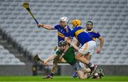 1 November 2020; Graeme Mulcahy of Limerick is tackled by Ronan Maher and Seán O'Brien of Tipperary during the Munster GAA Hurling Senior Championship Semi-Final match between Tipperary and Limerick at Páirc Uí Chaoimh in Cork. Photo by Brendan Moran/Sportsfile