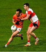 1 November 2020; Mark Shields of Armagh is tackled by Danny Tallon of Derry during the Ulster GAA Football Senior Championship Quarter-Final match between Derry and Armagh at Celtic Park in Derry. Photo by David Fitzgerald/Sportsfile