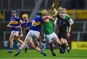 1 November 2020; Tom Morrissey of Limerick is tackled by Cathal Barrett of Tipperary during the Munster GAA Hurling Senior Championship Semi-Final match between Tipperary and Limerick at Páirc Uí Chaoimh in Cork. Photo by Brendan Moran/Sportsfile