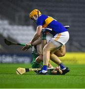 1 November 2020; Sean Finn of Limerick in action against Jake Morris of Tipperary during the Munster GAA Hurling Senior Championship Semi-Final match between Tipperary and Limerick at Páirc Uí Chaoimh in Cork. Photo by Daire Brennan/Sportsfile