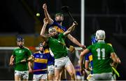 1 November 2020; Cian Lynch of Limerick and John Meagher of Tipperary contest a dropping ball during the Munster GAA Hurling Senior Championship Semi-Final match between Tipperary and Limerick at Páirc Uí Chaoimh in Cork. Photo by Brendan Moran/Sportsfile