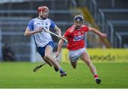 31 October 2020; Calum Lyons of Waterford in action against Daire Connery of Cork during the Munster GAA Hurling Senior Championship Semi-Final match between Cork and Waterford at Semple Stadium in Thurles, Tipperary. Photo by Brendan Moran/Sportsfile
