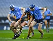 31 October 2020; John Donnelly of Kilkenny in action against Conor Burke, left, and Seán Moran of Dublin during the Leinster GAA Hurling Senior Championship Semi-Final match between Dublin and Kilkenny at Croke Park in Dublin. Photo by Ray McManus/Sportsfile