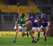 1 November 2020; Peter Casey of Limerick is tackled by Dan McCormack and Cathal Barrett of Tipperary, right, during the Munster GAA Hurling Senior Championship Semi-Final match between Tipperary and Limerick at Páirc Uí Chaoimh in Cork. Photo by Ray McManus/Sportsfile