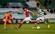 4 November 2020; Aaron Greene of Shamrock Rovers in action against Luke McNally, centre, and Brendan Clarke of St Patrick's Athletic during the SSE Airtricity League Premier Division match between Shamrock Rovers and St Patrick's Athletic at Tallaght Stadium in Dublin. Photo by Seb Daly/Sportsfile