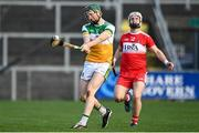 7 November 2020; Damien Egan of Offaly in action against Cormac O'Doherty of Derry during the Christy Ring Cup Round 2B match between Derry and Offaly at Páirc Esler in Newry, Down. Photo by Sam Barnes/Sportsfile