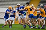 7 November 2020; Ryan Mullaney of Laois is tackled by Cathal Malone of Clare during the GAA Hurling All-Ireland Senior Championship Qualifier Round 1 match between Clare and Laois at UPMC Nowlan Park in Kilkenny. Photo by Brendan Moran/Sportsfile