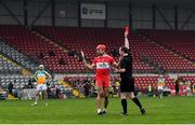 7 November 2020; Referee Colum Cunning shows a red card to John Mullan of Derry during the Christy Ring Cup Round 2B match between Derry and Offaly at Páirc Esler in Newry, Down. Photo by Sam Barnes/Sportsfile