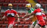 7 November 2020; Shane Kinsella of Offaly in action against Mark Craig, right, and Paddy Kelly of Derry during the Christy Ring Cup Round 2B match between Derry and Offaly at Páirc Esler in Newry, Down. Photo by Sam Barnes/Sportsfile