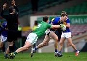 7 November 2020; Liam Casey of Tipperary is tackled by Darragh Treacy of Limerick as referee Maurice Deegan looks on during the Munster GAA Football Senior Championship Semi-Final match between Limerick and Tipperary at LIT Gaelic Grounds in Limerick. Photo by Piaras Ó Mídheach/Sportsfile