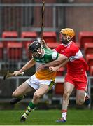 7 November 2020; Colm Gath of Offaly in action against Paddy Kelly of Derry during the Christy Ring Cup Round 2B match between Derry and Offaly at Páirc Esler in Newry, Down. Photo by Sam Barnes/Sportsfile