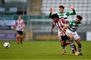 7 November 2020; Walter Figueira of Derry City in action against Roberto Lopes, right, and Dylan Watts of Shamrock Rovers during the SSE Airtricity League Premier Division match between Shamrock Rovers and Derry City at Tallaght Stadium in Dublin. Photo by Seb Daly/Sportsfile