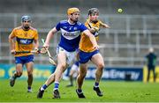 7 November 2020; Padraig Delaney of Laois in action against Tony Kelly of Clare during the GAA Hurling All-Ireland Senior Championship Qualifier Round 1 match between Clare and Laois at UPMC Nowlan Park in Kilkenny. Photo by Brendan Moran/Sportsfile