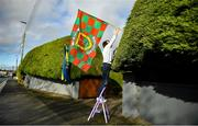8 November 2020; A local resident puts up flags prior to the Connacht GAA Football Senior Championship Semi-Final match between Roscommon and Mayo at Dr Hyde Park in Roscommon. Photo by Harry Murphy/Sportsfile