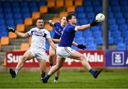8 November 2020; Andrew Farrell of Longford with team-mate Patrick Fox in action against Gary Walsh of Laois during the Leinster GAA Football Senior Championship Quarter-Final match between Longford and Laois at Glennon Brothers Pearse Park in Longford. Photo by Ray McManus/Sportsfile