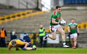 8 November 2020; Patrick Durcan of Mayo breaks the tackle by Cathal Compton of Roscommon during the Connacht GAA Football Senior Championship Semi-Final match between Roscommon and Mayo at Dr Hyde Park in Roscommon. Photo by Ramsey Cardy/Sportsfile