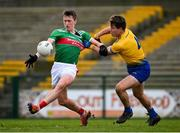 8 November 2020; Cillian O'Connor of Mayo in action against Seán Mullooly of Roscommon during the Connacht GAA Football Senior Championship Semi-Final match between Roscommon and Mayo at Dr Hyde Park in Roscommon. Photo by Ramsey Cardy/Sportsfile