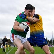 8 November 2020; Conor Loftus of Mayo is tackled by Cathal Compton of Roscommon during the Connacht GAA Football Senior Championship Semi-Final match between Roscommon and Mayo at Dr Hyde Park in Roscommon. Photo by Ramsey Cardy/Sportsfile