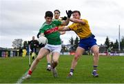 8 November 2020; Conor Loftus of Mayo in action against Niall Daly of Roscommon during the Connacht GAA Football Senior Championship Semi-Final match between Roscommon and Mayo at Dr Hyde Park in Roscommon. Photo by Ramsey Cardy/Sportsfile