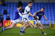 8 November 2020; Paul Kingston of Laois on his way to shoot a goal despite the attentions of Longford defenders Iarla O'Sullivan, left, and Donal McElligott during the Leinster GAA Football Senior Championship Quarter-Final match between Longford and Laois at Glennon Brothers Pearse Park in Longford. Photo by Ray McManus/Sportsfile