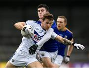 8 November 2020; Trevor Collins of Laois is tackled by Iarla O'Sullivan of Longford during the Leinster GAA Football Senior Championship Quarter-Final match between Longford and Laois at Glennon Brothers Pearse Park in Longford. Photo by Ray McManus/Sportsfile
