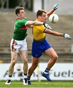 8 November 2020; Enda Smith of Roscommon in action against Patrick Durcan of Mayo during the Connacht GAA Football Senior Championship Semi-Final match between Roscommon and Mayo at Dr Hyde Park in Roscommon. Photo by Harry Murphy/Sportsfile