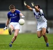8 November 2020; Dessie Reynolds of Longford is tackled by Gareth Dillon of Laois during the Leinster GAA Football Senior Championship Quarter-Final match between Longford and Laois at Glennon Brothers Pearse Park in Longford. Photo by Ray McManus/Sportsfile