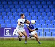 8 November 2020; Darragh Doherty of Longford is tackled by Trevor Collins of Laois, in front of an empty stand, during the Leinster GAA Football Senior Championship Quarter-Final match between Longford and Laois at Glennon Brothers Pearse Park in Longford. Photo by Ray McManus/Sportsfile