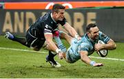 8 November 2020; Dave Kearney of Leinster dives to score his side's second try despite the attentions of Scott Williams of Ospreys during the Guinness PRO14 match between Ospreys and Leinster at Liberty Stadium in Swansea, Wales. Photo by Chris Fairweather/Sportsfile