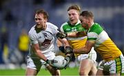 8 November 2020; Paul Cribbin of Kildare in action against Declan Hogan, right, and Carl Stewart of Offaly during the Leinster GAA Football Senior Championship Quarter-Final match between Offaly and Kildare at MW Hire O'Moore Park in Portlaoise, Laois. Photo by Piaras Ó Mídheach/Sportsfile