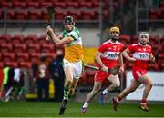 7 November 2020; Colm Gath of Offaly in action against Paddy Kelly, centre, and Richie Mullan of Derry during the Christy Ring Cup Round 2B match between Derry and Offaly at Páirc Esler in Newry, Down. Photo by Sam Barnes/Sportsfile
