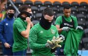 10 November 2020; Aaron Connolly examines the gloves of goalkeeper Mark Travers during a Republic of Ireland training session at The Hive in London, England. Photo by Stephen McCarthy/Sportsfile
