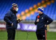 8 November 2020; Longford GAA commentator on Shannonside Radio John Duffy, left, interviews Longford manager Padraic Davis after the Leinster GAA Football Senior Championship Quarter-Final match between Longford and Laois at Glennon Brothers Pearse Park in Longford. Photo by Ray McManus/Sportsfile