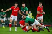 13 November 2020; Leigh Halfpenny of Wales is tackled by James Lowe of Ireland during the Autumn Nations Cup match between Ireland and Wales at Aviva Stadium in Dublin. Photo by Ramsey Cardy/Sportsfile