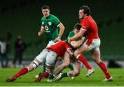 13 November 2020; Chris Farrell of Ireland is tackled by Shane Lewis-Hughes, left, and Ryan Elias of Wales during the Autumn Nations Cup match between Ireland and Wales at Aviva Stadium in Dublin. Photo by David Fitzgerald/Sportsfile