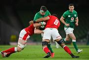 13 November 2020; Caelan Doris of Ireland is tackled by Alun Wyn-Jones, left, and Taulupe Faletau of Wales during the Autumn Nations Cup match between Ireland and Wales at Aviva Stadium in Dublin. Photo by Ramsey Cardy/Sportsfile