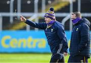 14 November 2020; Wexford selector Seoirse Bulfin tests the wind along his manager Davy Fitzgerald before the GAA Hurling All-Ireland Senior Championship Qualifier Round 2 match between Wexford and Clare at MW Hire O'Moore Park in Portlaoise, Laois. Photo by Piaras Ó Mídheach/Sportsfile
